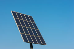 Solar cells in operation. Solar cells generating electricity against a blue sky Stock Photography