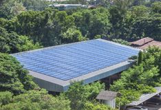 Solar cells or photovoltaics installing on roof factory turn up skyward absorb the sunlight from the sun. Rows array of polycrystalline silicon solar cells or stock photo