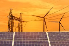 Solar cells in power station with high voltage electric pylon pillars substation on sunset stock photo