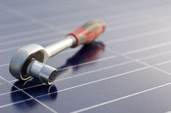 Solar cells and ratchet wrench stock photography
