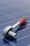 Solar cells and ratchet wrench Stock Photos