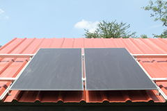 Solar cells on the red roof Royalty Free Stock Photos