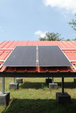 Solar cells on the red roof Stock Image