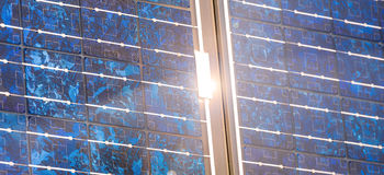 Solar cells and the sun. Some solar cells and the sun Stock Images