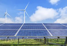 Solar cells with wind turbines generating electricity alternative renewable clean energy. In hybrid power plant systems station royalty free stock photo