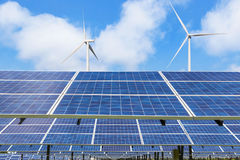 Solar cells and wind turbines generating electricity in  power station alternative renewable energy Royalty Free Stock Photo