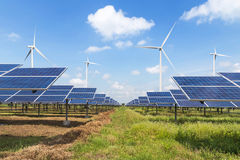 Solar cells and wind turbines in power station alternative renewable energy from nature Royalty Free Stock Photography