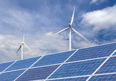Free Solar Cells With Wind Turbines Generating Electricity In Hybrid Power Plant Systems Station On Blue Sky Background Royalty Free Stock Image - 104037186
