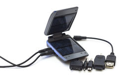 Solar charger with adapters. On white background Stock Images