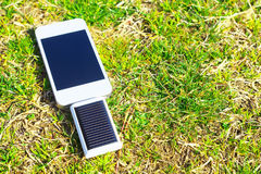 Solar charging of smartphone Stock Images