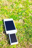 Solar charging of smartphone Stock Photos
