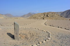 Solar clock ruins in Caral-Supe, Peru. Rock that was used as a sun clock in Caral Supe civilization, the oldest civilization of America, in Peru. This ruins are royalty free stock images