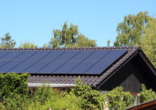 Solar collector on house roof with blue sky. Solarcell collector on house roof with blue sky Royalty Free Stock Photos