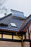 Solar collector on the roof of a house Royalty Free Stock Images