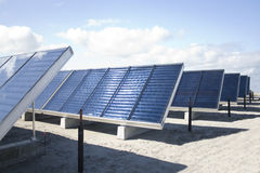 Solar Collectors. Rows of solar collectors. Alternative source of energy stock images