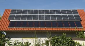 Solar Collectors. Solar heating and collectors in a modern ecological house royalty free stock photography