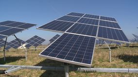 Solar collectors follow direction of sun. Sun energy usage for electricity. Generation. Modern technology. Timelapse shot stock footage