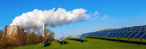 Solar collectors and fossil-fuel power station. Field with solar collectors and fossil-fuel power station stock images
