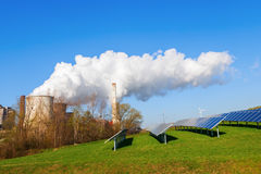 Solar collectors and fossil-fuel power station Royalty Free Stock Photos