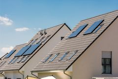 Free Solar Collectors On The Roof To Reduce Energy Costs Royalty Free Stock Photo - 144478035