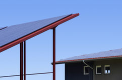 Solar collectors on rooftop Stock Photos