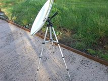 Solar Cooking converted satellite dish Parabolic mirror dish on a stand for solar cooking. Solar Cooking converted satellite dish Parabolic mirror dish on a royalty free stock images
