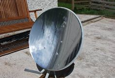 Solar Cooking converted satellite dish Parabolic mirror dish on a stand for solar cooking. Solar Cooking converted satellite dish Parabolic mirror dish on a stock photography