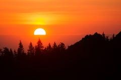 The solar disk rises on the horizon Stock Photos