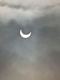 Solar eclipse. Partial solar eclipse (the 4th of January 2011) on a cloudy sky Stock Photos