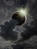 Solar eclipse. Dramatic stormy grey cloudscape with a solar eclipse stock image