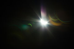 Solar eclipse  with solar burst and lens flare Stock Image