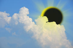 Solar eclipse with clouds Royalty Free Stock Image