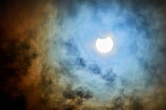 Solar Eclipse on a cloudy day. royalty free stock photos