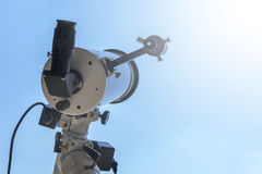 Solar eclipse observing with telescope. Telescope with solar fil Royalty Free Stock Photography