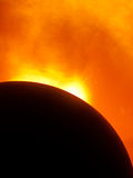 Solar eclipse. On an orange abstract background Royalty Free Stock Photography