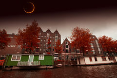 Solar Eclipse over the city Amsterdam. Elements of this image fu Stock Image