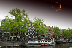 Solar Eclipse over the city Amsterdam. Royalty Free Stock Image