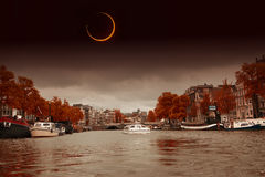 Solar Eclipse over the city Amsterdam. Royalty Free Stock Photography