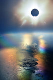 Solar Eclipse. Over Earth, seen from high altitude, and reflecting on the ocean above Stock Photo