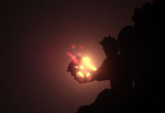 Solar eclipse. Partialy covered by statue of an angel on the roof Stock Photos