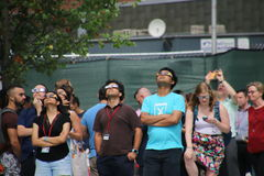 Solar Eclipse 2017. People watching the partial solar eclipse on the Cornell Tech campus, Roosevelt Island, New York Royalty Free Stock Image