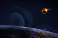 Solar Eclipse on Starry Sky. Solar eclipse with orange halo over the planet Earth, on dark starry sky. Elements of this image furnished by NASA Stock Photos