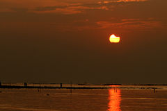 Solar eclipse at sunset. Solar eclipse during sunset at the most western beach in Hong Kong namely Ha Pak Lai.   It is a very rare event which happened in Hong Royalty Free Stock Photos