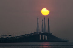 Solar eclipse view of Penang Bridge, Malaysia. Beautiful landscape series of sunrise and sunset collection from George Town, Penang, Malaysia Stock Photo
