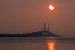 Solar eclipse view of Penang Bridge, Malaysia. Beautiful landscape series of sunrise and sunset collection from George Town, Penang, Malaysia Stock Image
