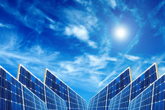 Solar energy. Solar panels collecting energy from the sun in the sky Stock Images
