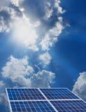 Solar energy. Group of four solar panels on sunny blue sky background Stock Image