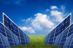 Solar energy. Panels for solar energy in a meadow, with clear blue sky Royalty Free Stock Image