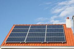 Solar energy. Solar panels on a house roof h stock images