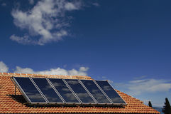 Solar energy. Solar cells for ecological energy on a roof of a family home Stock Photo